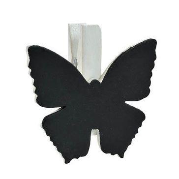 Kleine Holzklammern mit Schiefertafeln in Schmetterlingsform zur Beschriftung mit Namen als originelle Tischkarten für die Hochzeit