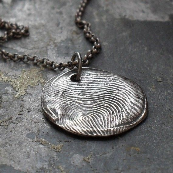 a must have...fingerprint necklace of my loved ones