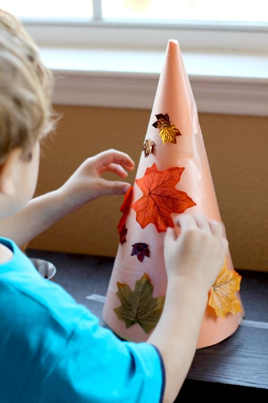 Create fall trees with repositionable leaves- a perfect way to introduce the concept of fall leaves to toddlers!