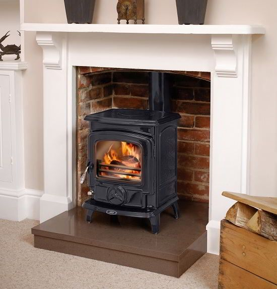 Gas Stove Inside Fireplace With Exposed Brick Interior