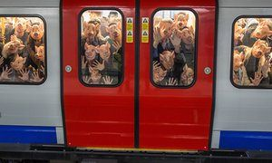 Campaigners crush into a busy London tube, to show the conditions pigs face in factory farms