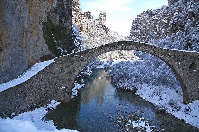 Kokkoris old bridge in winter, Epirus, Greece. www.house2book.com