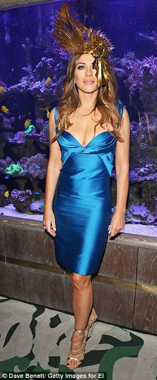 Dazzling: Liz Hurley opted for something rather special for the occasion in fitting aqua blue dress at the Sexy Fish venue