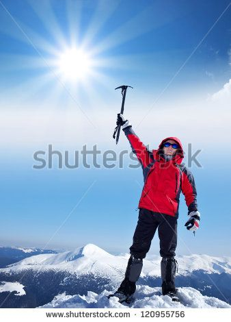 Rock climber on the snow summit. Sport and active life - stock photo