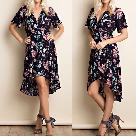 "Shop Women's Pink Peplum Boutique size Various High Low at a discounted price at Poshmark. Description: HOTTEST TREND for 2017!!!!!!!!!!! Floral print wrap dress, a must have for every fashion lover!   Features: Floral print woven dress with wrap around style skirt with ties at waist Pleated front for draped appeal Fly away sleeves Lined hi-low skirt Material: 100% Rayon MADE IN USA Length approximately at front and back: 36""-38"" and 46""-47""  Measurements:  Small: Size..."
