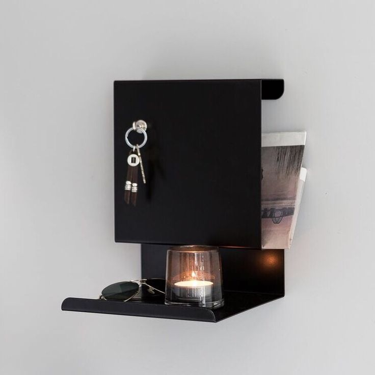 Ledge:able shelf by the bed or in the hallway. Magnetic and practical!
