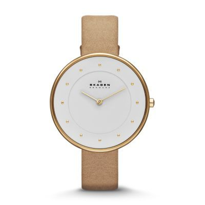 The simplified, contemporary Gitte Women's Leather Watch features a wide-open monochromatic face broken up only by a soft bezel with index dots marking the hours. The large 38-mm case is contrasted by a thin 14-mm leather band for a look that can go either way, dress or casual.