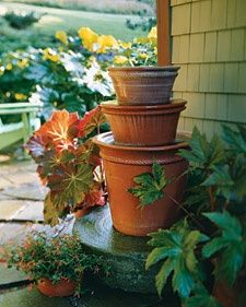 You dont need a lakefront property to enjoy the benefits of backyard water. Stacked pots filled with a pump and filled to the brim produce sounds  reminiscent of lapping waves. The vessels rolled rims -- and resulting cascades -- amplify the sound of the water, and their coloring corresponds with a  nearby begonia.