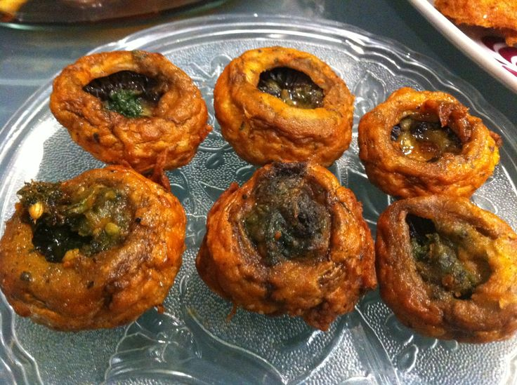 It is a traditional snack from south east asia made of gram flour, onions, salt, spices and fried in oil. These are normally eaten with mint sauce, tomato ketchup. Yummmyy and tasty