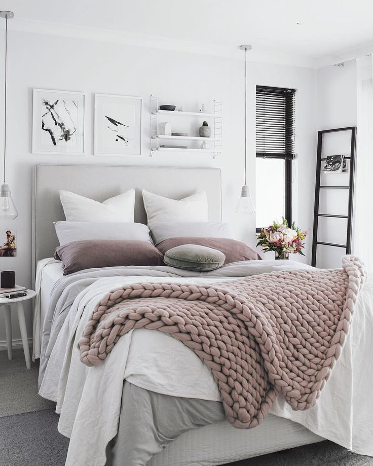 Neutral Bedroom With An Upholstered Bed Frame And A Chunky Knit Throw Blanket