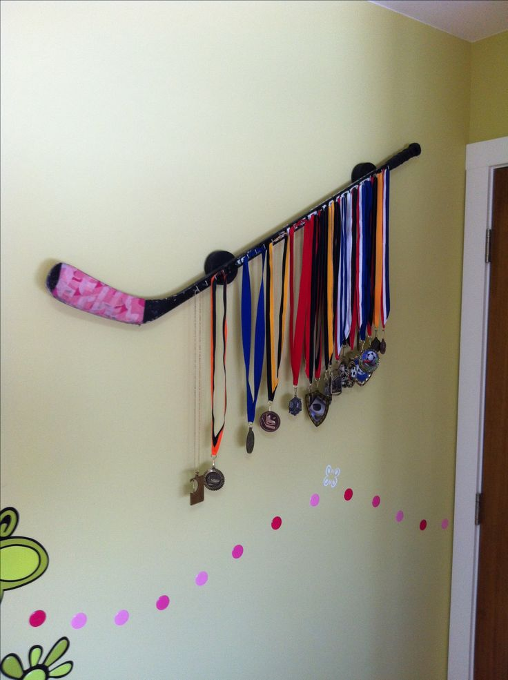 Nice DIY Idea: A Hockey Stick With Metal Hooks As Medal Display. Pictures
