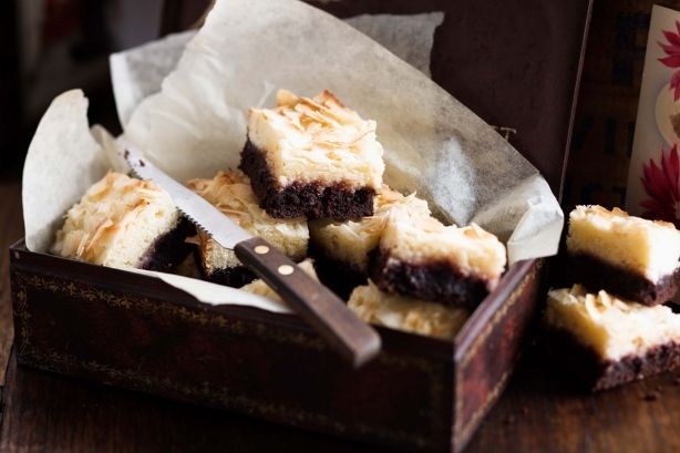 Layered with chocolate, raspberry jam and golden-baked coconut, guests will adore this Christmas treat.