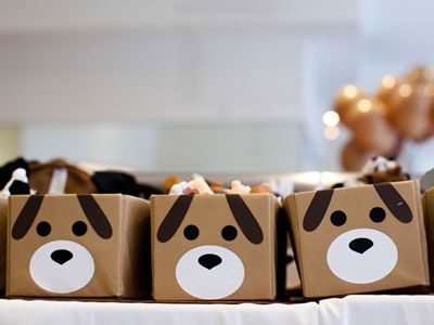 Little dog face boxes. Great for holding snacks and candy, or for party favors.