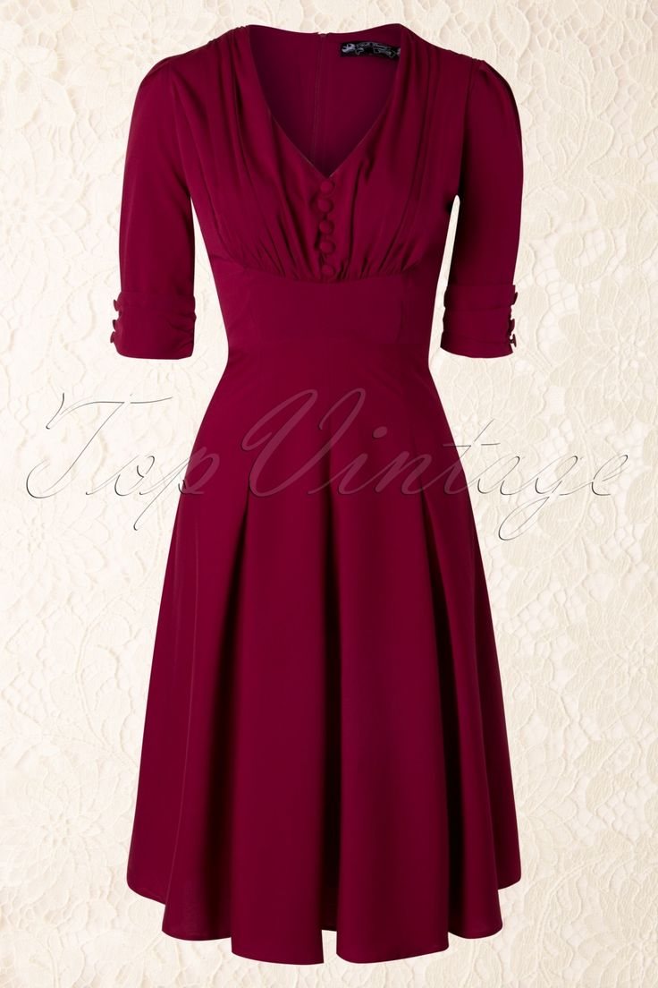 LOVE THIS!!!  New collection - This 40s June Dress in Raspberry Red by Bunny is an elegant dress in vintage 40s style with playful details.  The fitted bodice is fully pleated, has an elegant v-neck and is decorated with fake, fabric covered buttons. The 3/4 sleeves are slightly pleated at the top and the shoulder padding will give you a beautiful pronounced silhouette, trés chique! From the waist down ending in a flowing skirt with flattering box pleats that hits below the knee with a ...