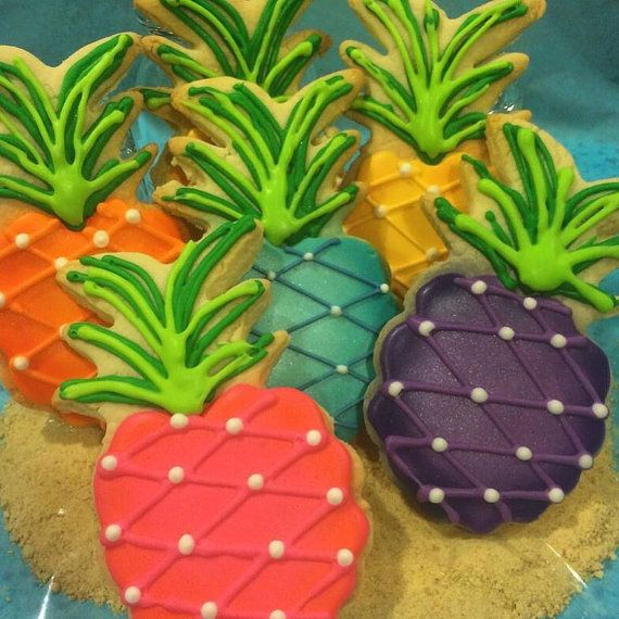Pineapples are HOT this year, which is fitting because in all seriousness, who doesnt like pineapple? Taking it further, who doesnt like *rainbow* pineapple? When I designed this cookie set, I was inspired by the gorgeous colors of Hawaii, the feel of relaxing on the beach by day, and dancing in the moonlight at night. Basically, I was inspired by my ideal vacation!  WHATS INCLUDED: This particular set comes with 12 cookies that are packed in heat-sealed cellophane and wrapped in our…