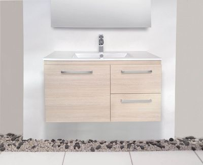 900mm centre basin. 500mm height. This drawer configuration is good. But without handles  It's actually a cupboard and two drawers. This layout v single wide drawer allows one person to access storage whilst another is using the vanity. All drawer means you have to move away to access storage. ADP Glacier Ceramic Twin #vanity