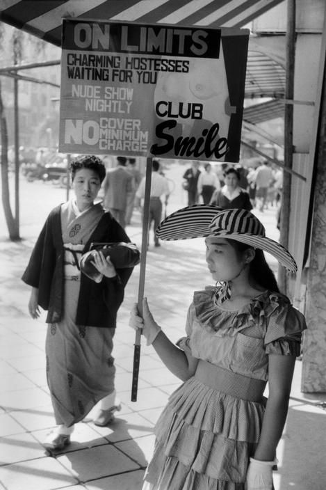 Charming hostesses waiting ...for you, 1958 by Marc Riboud
