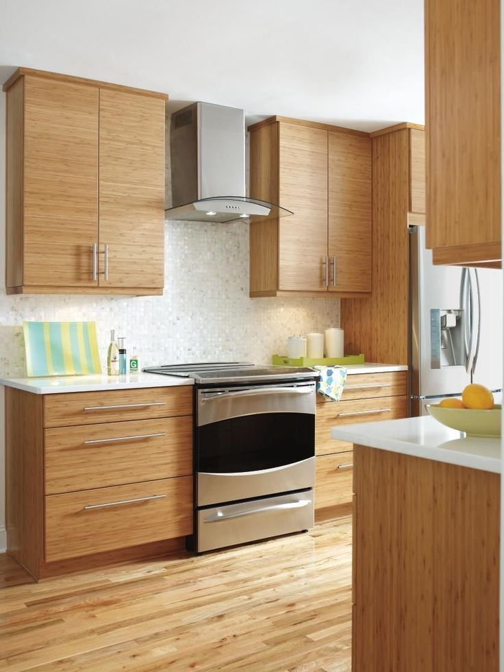 The clean lines and modern look of Kitchen Craft's Summit Horizontal Bamboo cabinets allows the beauty of natural light and the new, open floor plan to shine in this renovated kitchen.