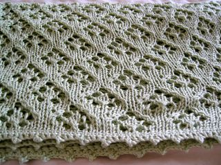 Designed to be a quick knit for a baby gift. The lace pattern is based off of Barbara Walker's Elfin Lace stitch. The borders could be either a crochet picot edging or a garter edging depending on the preference of the knitting. The wool bamboo blend makes the blankie warm and snuggly, perfect for naps for you little one!