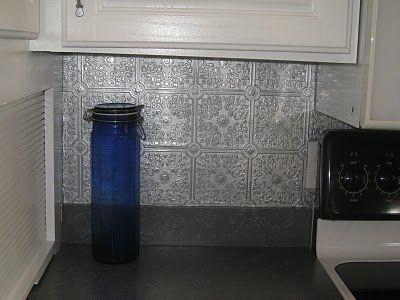Mybre just part behind stove Spray paint paintable wallpaper silver for an expensive looking backsplash!