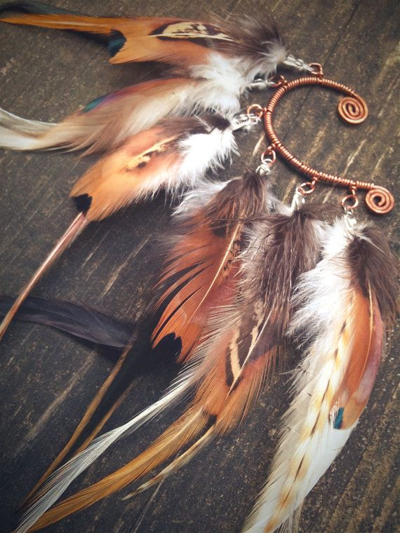 full wing feathered ear cuffs. i know how to make these, so i'm considering making this beautiful monstrosity.