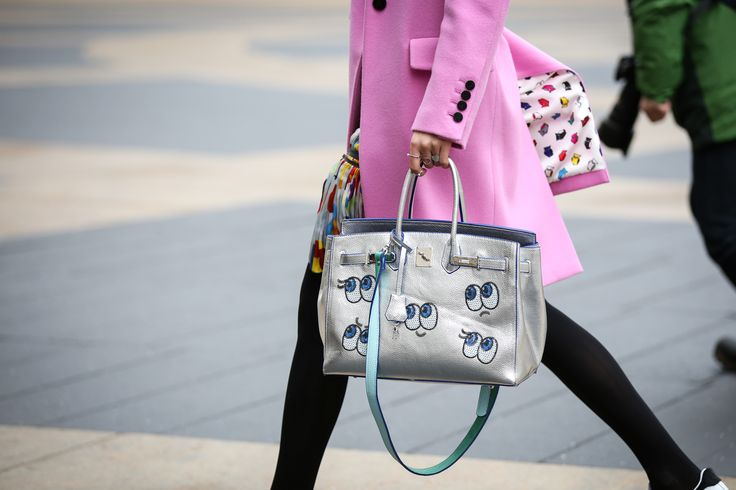 40+ Seriously Cool Bags Spotted On The Streets Of NYC #refinery29  http://www.refinery29.com/best-bags-of-nyfw-2015#slide-31  Eye see you!Hermès bag, Anya Hindmarch stickers.
