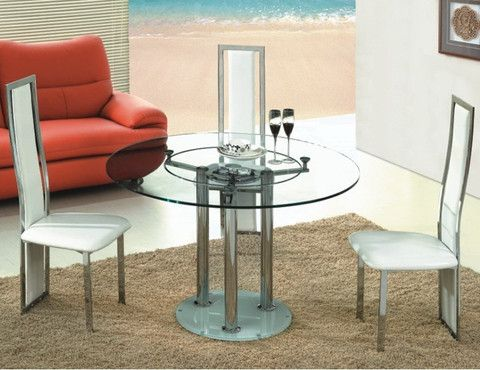 The Adelle Dining Table is a simple and clean-cut modern design. Its thick high-quality round glass attaches to three chrome legs and chrome base, and it features a lazy susan in the middle which is unlike any other table. This would be a beautiful piece in any small dining area, and is great for condos.