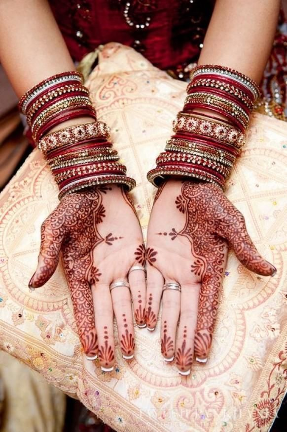 In Indian culture, mehndi is applied to the hands. This is a type of henna design assisted my the brides friends. It represents the beauty of marriage and good fortune.