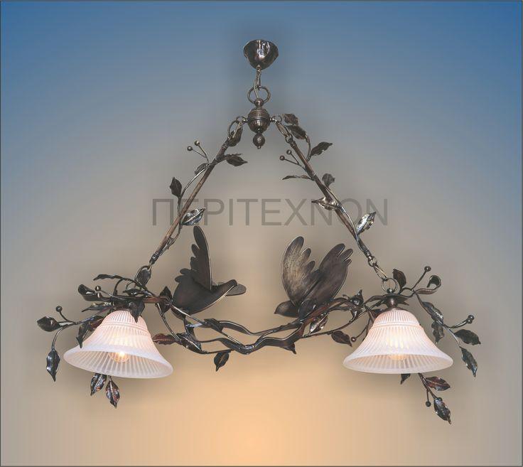 Μία δημιουργία του Βασίλη Αθανασόπουλου από την σειρά τα ''περιστέρια της ψυχής μου''. Ένα φωτιστικό για τον χώρο της τραπεζαρίας http://peritexnon.weebly.com/