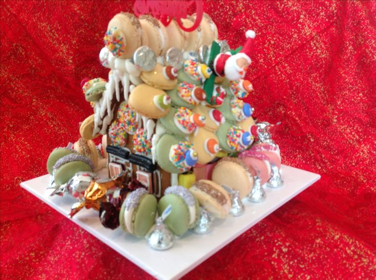 Standard sized gingerbread houses decorated with macarons and  lots of sweets and rock candy