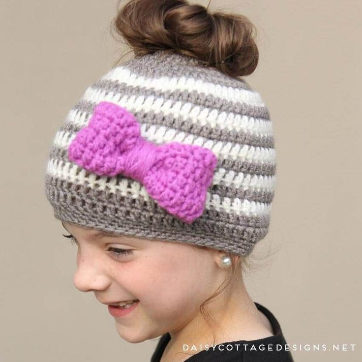Use this messy bun hat crochet pattern to make a fun hat for your little girl. This ponytail hat is the perfect way to keep your little girl's head warm!