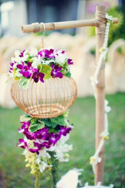 Tropical wedding flowers- purple and white dendrobium orchids