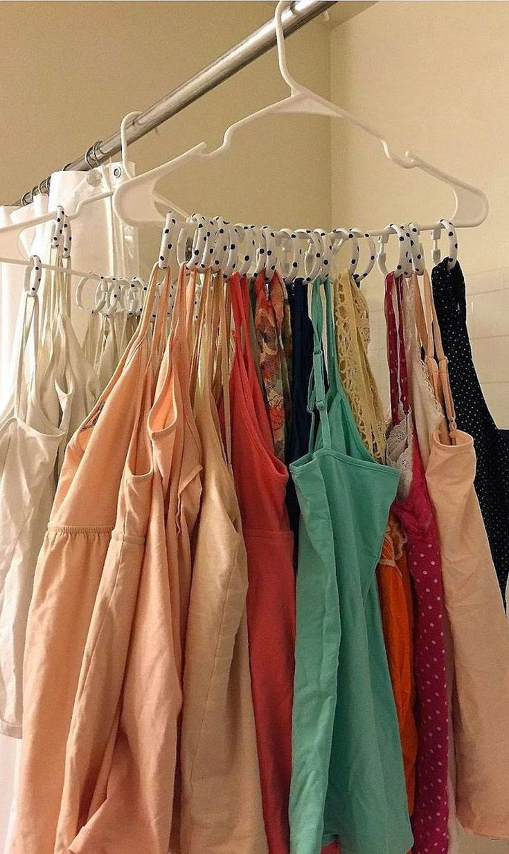 Use shower hooks to hang tank tops in a closet.