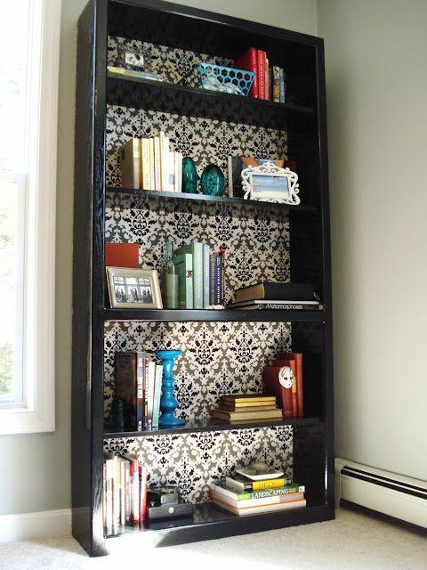 Cool DIY bookcase makeover (love the shelf arrangements)
