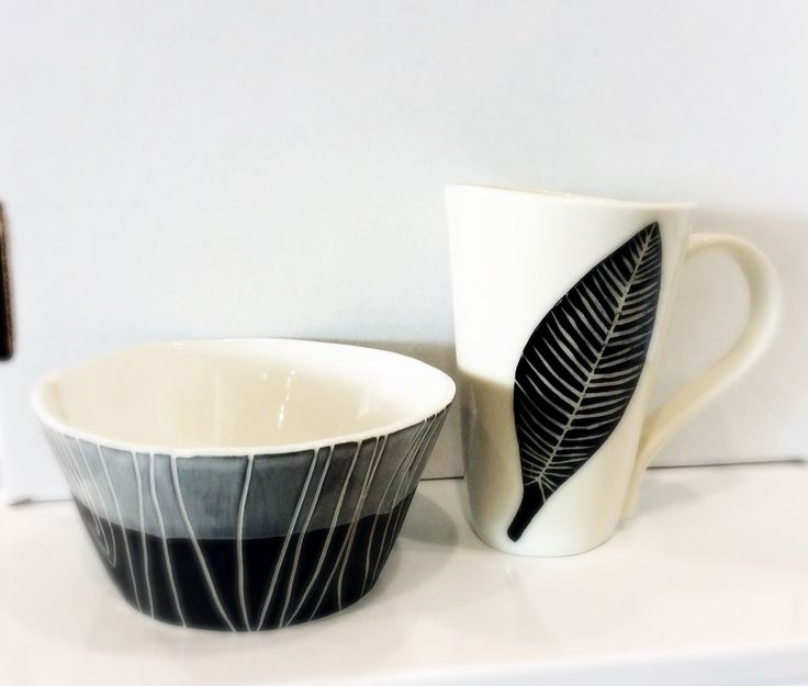 New pottery has arrived at the Shop at AGH by Two Cent Sparrow. Kristen's ceramic work mimics the aesthetic found in picture books and graphic novels. a full range of mugs and bowls in graphic grey and black and white make a great gift. #shopatagh #artgalleryofhamilton