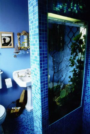 Aquarium / fish tank built in to the shower.  Wow!