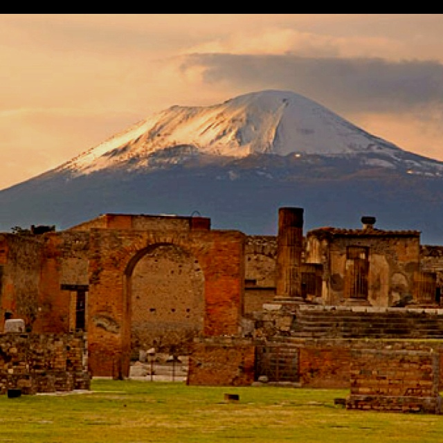 Pompeii with Mt. Vesuvius in the background. I would love to visit this extraordinary place one day...