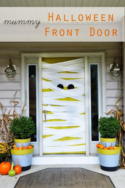 """halloween front door- My kids thought I was the coolest """"Mummy"""" around... see what I did there? :)  Tons more fall decorating ideas in this post."""