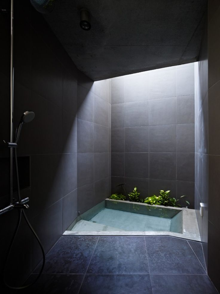 skylight window in this bathroom acts like a spot light to highlight the bathroom's main feature
