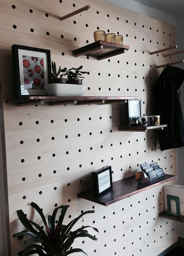 "Large scale ""pegboard"" feature wall made of ply and dowl"