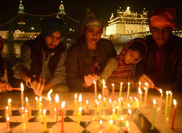 a family lighting candles