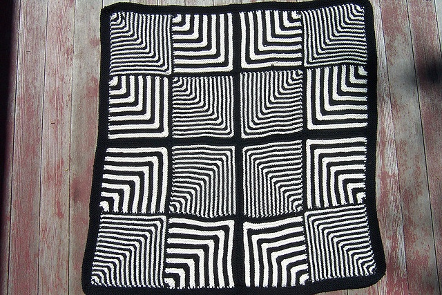 Mitered Baby Blanket by Linda Daniels -- one pattern for the squares, some have single stripes and some double, arranged per the pattern
