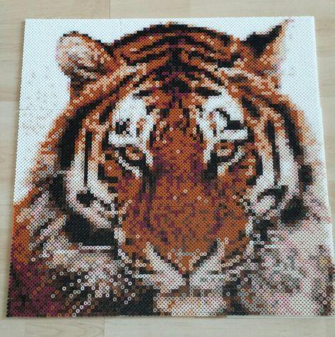 Tiger lavet af fotoperler.  http://www.hobbyshoppen.dk/1135/Fotoperler---Photopearls.html