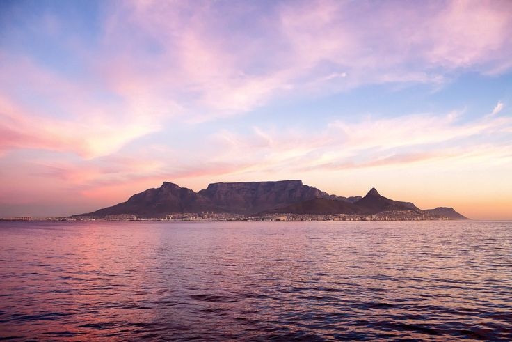 This is Table mountain, a national landmark. It is near the city of Cape Town, in South Africa