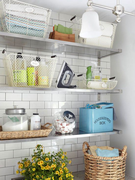 Orderly Open Shelves:  Three deep metal shelves hold a bevy of laundry and cleaning supplies. A stylish mix of of new and vintage containers makes it easy to find essential kits for each step of the laundry process.