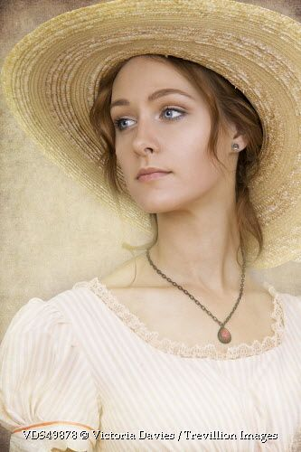 Trevillion Images - young-woman-in-straw-hat
