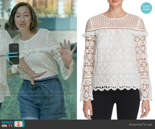 Carol's white lace ruffled top on Last Man on Earth.  Outfit Details: https://wornontv.net/62426/ #LastManOnEarth