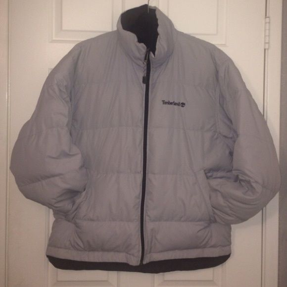 Perfect Winter REVERSIBLE two-color jacket. Best jacket for cold weather ever. Reversible: baby-blue and black. One pockets converts to its pouch for storage - perfect for traveling! *on the sleeve it has a small pinkish pen ink smear, it's very unnoticeable Timberland Jackets & Coats Puffers