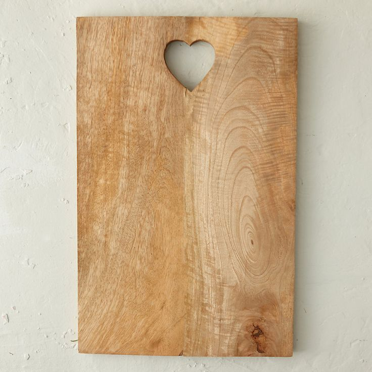 """Inspired by traditional, Nordic design, this mango wood cutting board features a sweet heart at its top.- Mango wood- Hand wash, treat with wood oil as needed- Indoor use only- Imported0.75""""H, 12.25""""W, 19""""L"""