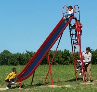 Playground slides were a lot higher back then. I slipped while trying to climb up it backwards and needed stiches where I bit my lip.